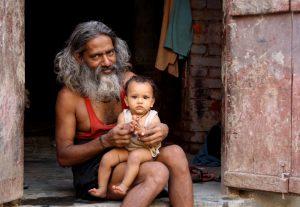 Man holding a Baby in Varanasi