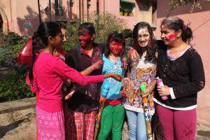 Children in Delhi playing Holi
