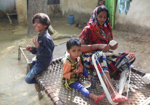 Lady Making Sacred Threads in Varanasi