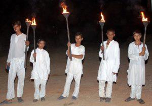 Torch bearing boys at Samode